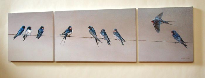 swallows sitting on a wire print - canvas triptych print